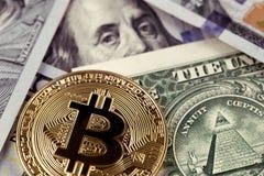 Bitcoin logo on dollars close up Stock Photos