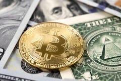 Bitcoin on dollars close up Stock Photo