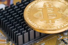Bitcoin metallic coin on chip cooler Stock Image