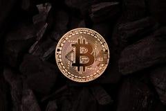 Bitcoin mining concept. Bitcoin cuurency on charcoal stock image