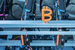 Bitcoin on a mining farm. Plasticine bitcoin stands on the computer for mining crypto currency Stock Image
