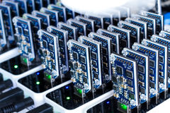 Bitcoin mining. USB devices in a row with small fans Stock Images