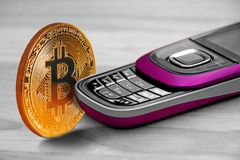 Bitcoin and mobile phone stock image