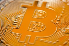 Bitcoin monet coin currency closeup. Bitcoin currency DOF on blue glass background. Gold metal curency symbol macro photo closeup stock illustration
