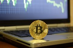 Bitcoin money on computer laptop, Monitoring the exchange rate and investment in bitcoins. Coin bitcoin on a laptop. Exchange cryptocurrency quotes on the laptop stock photography