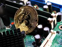 Bitcoin on motherboard. Combination of Bitcoin and the technology behind it Stock Image