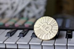 Bitcoin and music keyboard. Digital currency physical metal bitcoin coin and music keyboard. Cryptocurrency sound concept royalty free stock photos