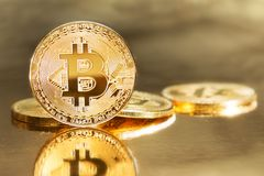 Bitcoin is new gold. Physical golden representation of virtual cryptocurrency bitcoin Royalty Free Stock Photo