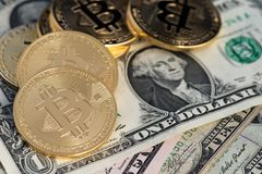 Bitcoin new virtual money and banknotes of one dollar. Exchange bitcoin for a dollar. Conceptual image for worldwide cryptocurrency and digital payment system stock images