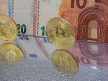 Bitcoin och euro` s Fotografering för Bildbyråer