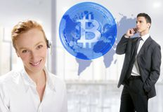 Bitcoin office traders brokers woman and man. Bitcoin office traders brokers women and businessman with world map and smartphone Stock Photo