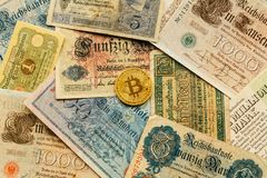 Bitcoin with old deutsch money. Cryptocurrency Blockchain concept background. Closeup with copy space. Bitcoin with old german money. Inflation of paper money Stock Photo