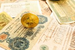 Bitcoin with old deutsch money. Inflation. Cryptocurrency concept background. Closeup with copy space. stock photos