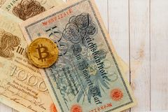 Bitcoin with old deutsch money. Inflation of paper money. Cryptocurrency concept background. Closeup with copy space. Bitcoin with old german money. Inflation Royalty Free Stock Images