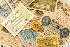 Bitcoin with old deutsch money. Inflation of paper money. Cryptocurrency Blockchain concept background. Closeup with copy space. Bitcoin with old german money Royalty Free Stock Photography