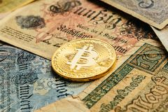 Bitcoin with old deutsch money. Inflation of paper money. Cryptocurrency Blockchain concept background. Closeup with copy space. Bitcoin with old german money Stock Image