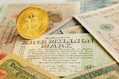 Bitcoin with old deutsch money. Inflation of paper money. Cryptocurrency concept background. Closeup with copy space. Bitcoin with old german paper money Stock Photo