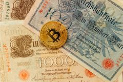 Bitcoin with ancient deutsch money. Cryptocurrency concept background. Closeup with copy space. royalty free stock photos