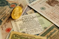 Bitcoin with old deutsch money. Inflation. Cryptocurrency concept background. Closeup with copy space. Bitcoin with old german money. Inflation 1923, one Stock Image