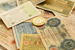 Bitcoin with old deutsch money. Inflation of paper money. Cryptocurrency concept background. Closeup with copy space. stock photos
