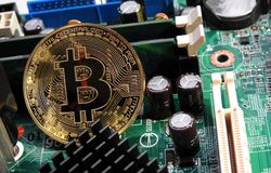 Free Bitcoin On Motherboard Royalty Free Stock Photography - 92249097