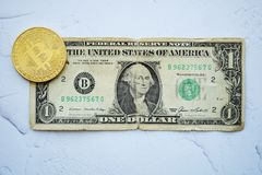 Bitcoin on one american dollar, digital money stock photos