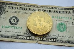 Bitcoin on one american dollar, digital money royalty free stock photos