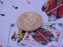 Bitcoin and open deck of cards. Royalty Free Stock Photography