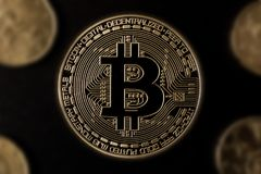 Bitcoin and other coins. Black background Royalty Free Stock Image