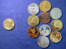 Bitcoin and others crypto coin on blue cloth. Virtual cryptocurr Stock Photos
