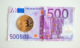 Bitcoin over five hudred euro bill Royalty Free Stock Images