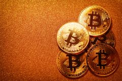 Bitcoin over gold glitter background. Business concept. Stock Photography