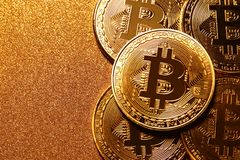 Bitcoin over golden glitter background. Business concept. Stock Photography
