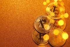 Bitcoin over golden glitter background. Business concept. Royalty Free Stock Images