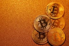 Bitcoin over golden glitter background. Business concept. Stock Images