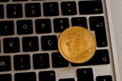 Bitcoin over a laptop`s keyboard stock image