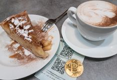 Bitcoin payment in cafe. Crypto currency concept Royalty Free Stock Photography