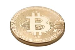 Bitcoin. Physical bit coin. Golden coin with bitcoin symbol isolated on white background. Bitcoin. Physical bit coin. Digital currency. Cryptocurrency. Golden Stock Photography