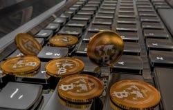 Bitcoin physical coin symbol on keyboard, 3D illustration Stock Photos
