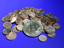 Bitcoin on  a pile of Euro cents. Bitcoin on pile of copper Euro centsn Stock Photo