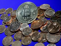 Bitcoin on  a pile of Euro cents. Bitcoin on pile of copper Euro centsn Royalty Free Stock Image