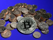 Bitcoin on  a pile of Euro cents. Bitcoin on pile of copper Euro centsn Stock Image