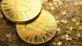 Bitcoin Pile Falls Down with Golden Stars Shower Macro stock video footage