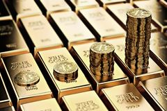 Bitcoin piles on rows of gold bars gold ingots. Bitcoin keep growing and it is as desirable as gold concept. Royalty Free Stock Photos
