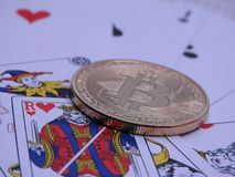 Bitcoin and playing cards in background. Stock Photography