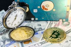 Bitcoin and pocket watch on us dollars with hard disk Stock Images