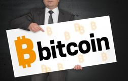 Bitcoin poster is held by businessman stock photography