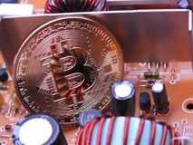 Bitcoin and power board components Royalty Free Stock Photography