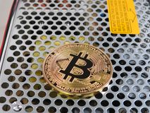 Bitcoin on power supply Royalty Free Stock Image