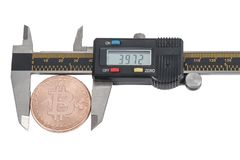 Bitcoin price in a vernier caliper. Using a caliper to measure the price of bitcoin, isolated on white background stock photos
